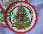 Four vintage toy tin Christmas plates