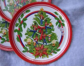Four vintage toy tin Christmas plates