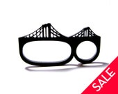 brooklyn bridge three-finger brass knuckles acrylic ring