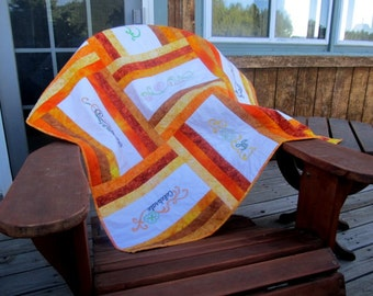Lap quilt or Baby Blanket Gift in Orange and Yellows with Embroidery