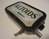 Mint Tin Pocket Guitar Amp, Headphone Amp, MP3 Amp w/ Speaker, Volume Control, & 10X Gain (Black Liquorice Altoids)