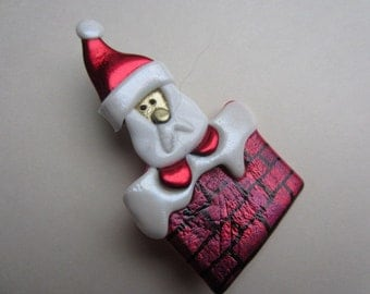 Santa in the chimney pin brooch