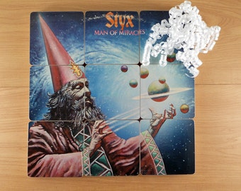 Styx handmade wood coasters with warped record bowl from recycled Man of Miracles music album