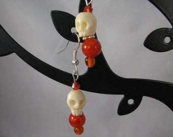 Medium stone skulls with red-orange beads and Swarovsky crystals sterling dangle earrings