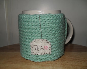 Knitted tea mug cozy cup cozy in seafoam green with hanging TEA patch with heart
