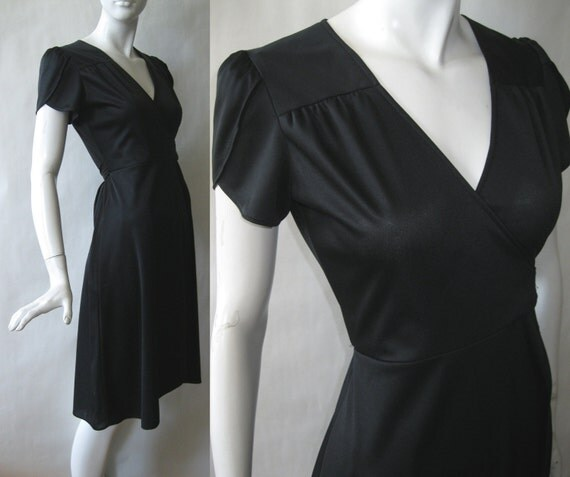Vintage black wrap dress with petal sleeves and hem, 1970's, small