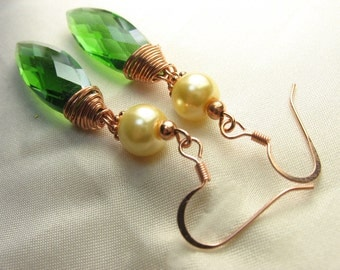 Green with envy ... green dagger crystal pendant earrings with ivory glass pearls and copper wire wrap and findings