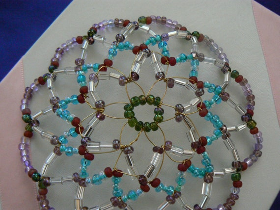 Clearance Kippah Sale!!!!Beaded kippah handmade in shades of aqua, green, purple, ruby red and clear beads.