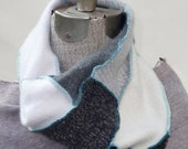 Luscious Cashmere Cowl Scarf pieced in black, white, grey and pattern with a turquoise serge