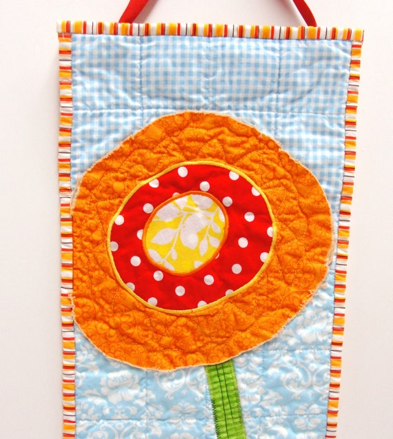 poppy wall quilt- single stem orange, yellow and red poppy on blue, wall art, wall hanging