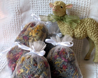 Herbal Sachet a blend of fresh dried herbs, lavender, rose and calendula in white organza bag sample size