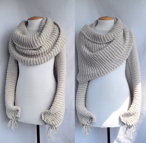 Bolero shawl scarf with sleeves at both ends in light beige.
