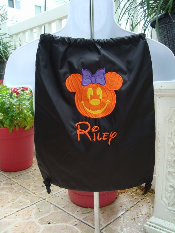 Trick or treat in style with this adorable Mickey or Minnie tote bag
