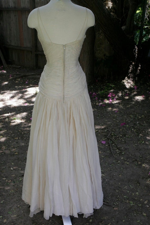 Vintage wedding dress with double spaghetti strap gathered bodice, straight front skirt, gathering back Size Small
