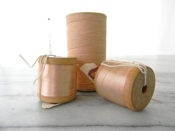 Bundle of Ballerina Pink Satin Threads on Wooden Spool - French