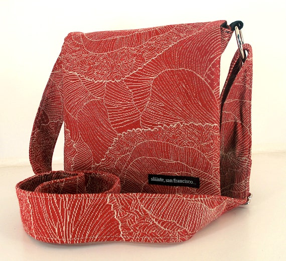 "Hip Bag in ""Red Sketch Flowers"" Fabric. Warm red background with tan details. Made in San Francisco."