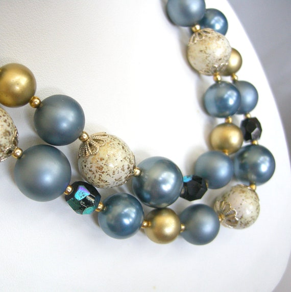 Vintage blue, gold, and cream beaded double strand necklace, marked Japan