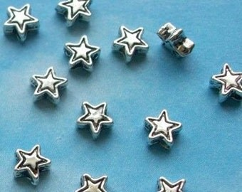 100 very tiny star beads, etched outline, silver tone, 4mm