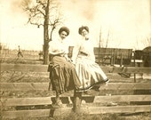 Edwardian Women on Fence with Train in Background Cabinet Photo