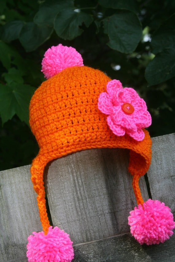 Toddler Girl hat earflap poms crocheted in orange and hot pink with button flower accent 12-36 months Custom colors and sizes available