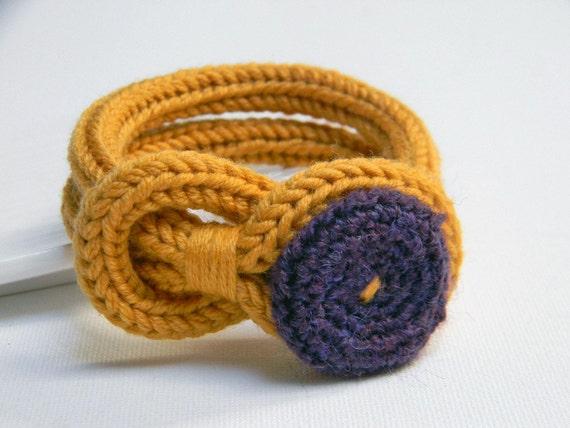 Mustard yellow and purple knitted wool yarn bracelet Noemi, crocheted button, tied up, yarn jewelry