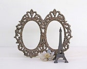 vintage metal picture frame silver toned double oval shape scroll design