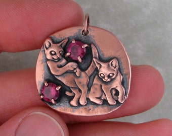 Cats playing kittens copper pendant with ruby cubic zirconias DTPD