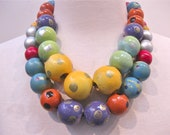 double strand of hand painted wood beads in bright colors.