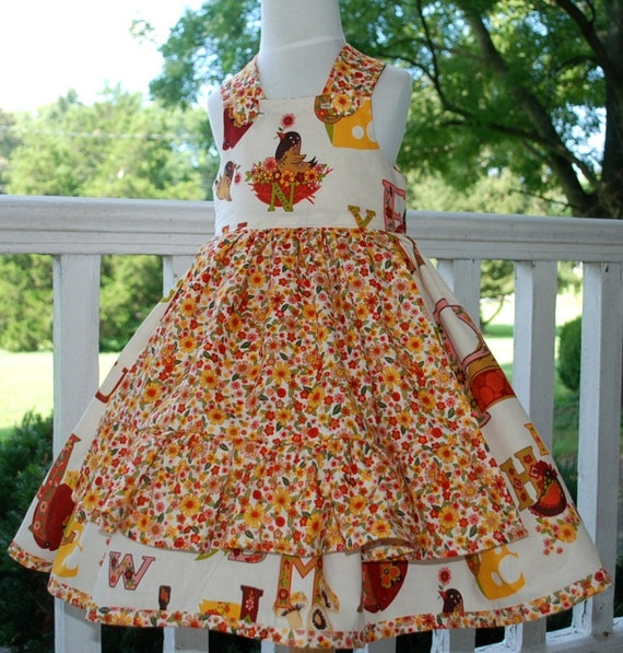 Custom order for Carol Size 5 Autumn dress in ABC cookery fabric with ruffled apron and big buttons