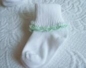 Mint green hand crocheted baby socks
