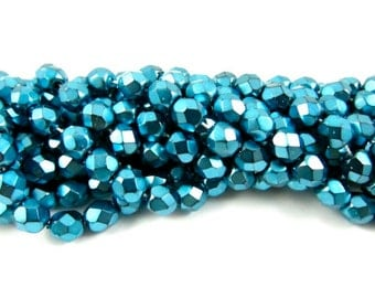 30 - Round Czech Fire Polished Faceted Glass Beads - Pearlized Aqua on Jet - 6mm .