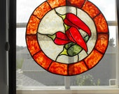 Framed painted glass suncatchers--Red and green peppers