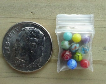 10 Miniature Glass Marbles by J. R. Hooper