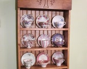 tea cup shelf. collectors shelf, 12 cup Willow pattern