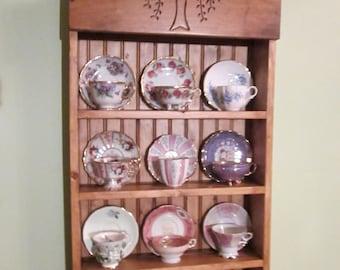 tea cup shelf. collectors shelf, 12 cup Willow pattern