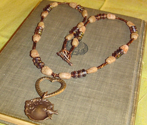 Sweet bird and heart necklace in copper and earthtones