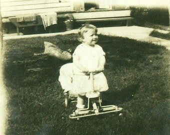 1920s Toddler Girl on Riding Toy Walker Wheel Car Outside Vintage Antique Black and White Photo Photograph