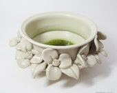 Ceramic Flower Bowl in Creamy White with an Emerald Green Glass Puddle.