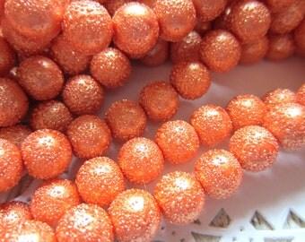 Orange glass beads 40 textured 10mm round sugar style