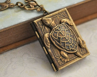 turtle locket necklace - BEST OF FRIENDS - sea turtle and sprrrow bird book style locket necklace in antiqued brass