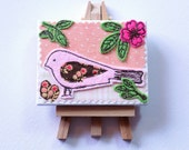 Pink bird mini art canvas. With embroidered felt bird, leaves and flowers.