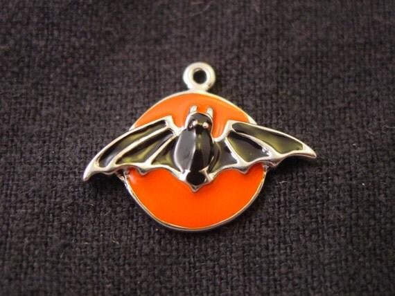 black and orange halloween bat charm