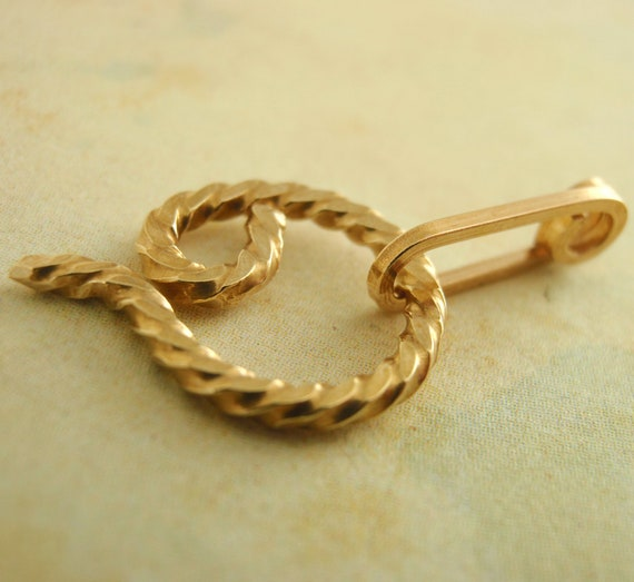 Hand forged twisted swirl clasp in copper brass bronze