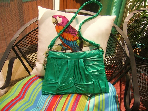 green purse shoulder style..very unique...with braided strap and charms..Ayla is enchanting.....