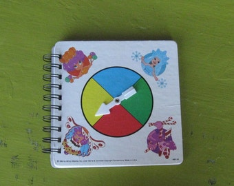 notebook from a recycled game spinner