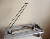Industrial Chic. Vintage Wood and Metal Pulley or Dolly.