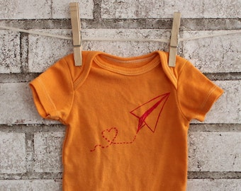 "Paper airplane baby bodysuit, ""Love Notes"" infant creeper, one piece snapsuit in orange, Screen printed shirt, Hand Printed, Short Sleeved"