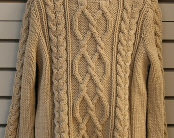Hand-knitted cabled sweater