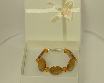 Mother of pearl and Swarovski crystal bracelet in amber and gold