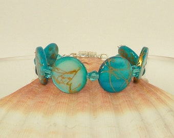 Mother of pearl and Chinese crystal bracelet in pale turquoise blue